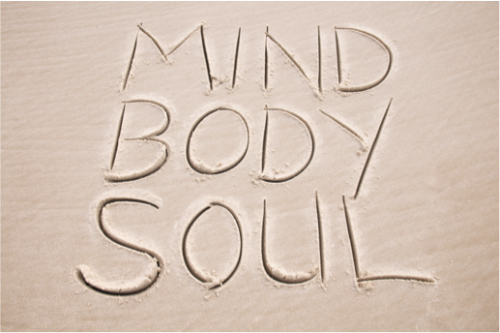 Mind body soul written in sand